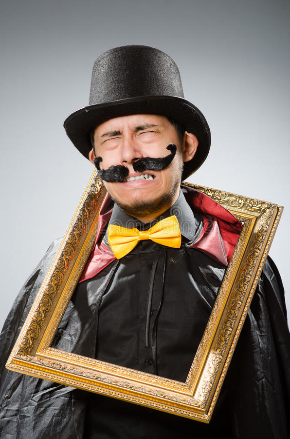 Смешной человек с картинной рамкой стоковое фото rf