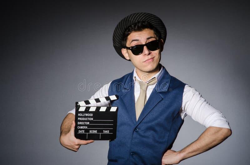 Смешной человек с кино стоковые изображения