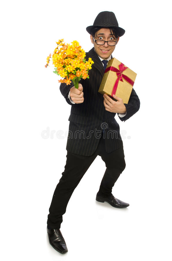 Смешной человек с цветками и giftbox стоковые изображения