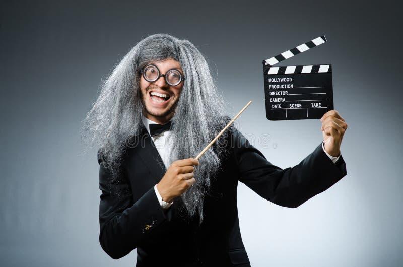 Смешной человек с clapboard кино стоковая фотография rf