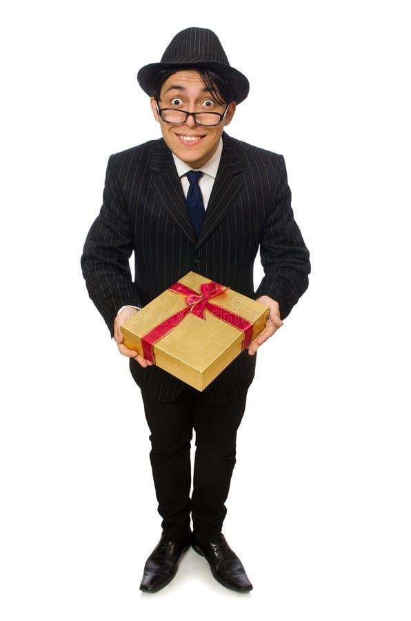 Смешной человек с giftbox на белизне стоковые изображения rf
