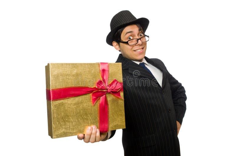 Смешной человек с giftbox на белизне стоковые фото