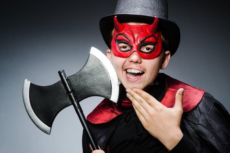 Смешной дьявол против стоковые фото