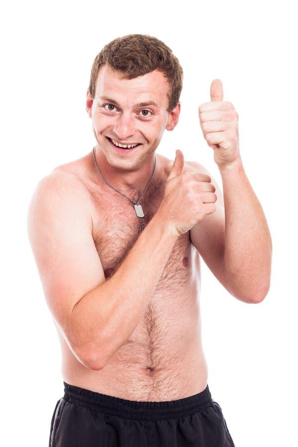 Смешные без рубашки большие пальцы руки человека вверх стоковая фотография