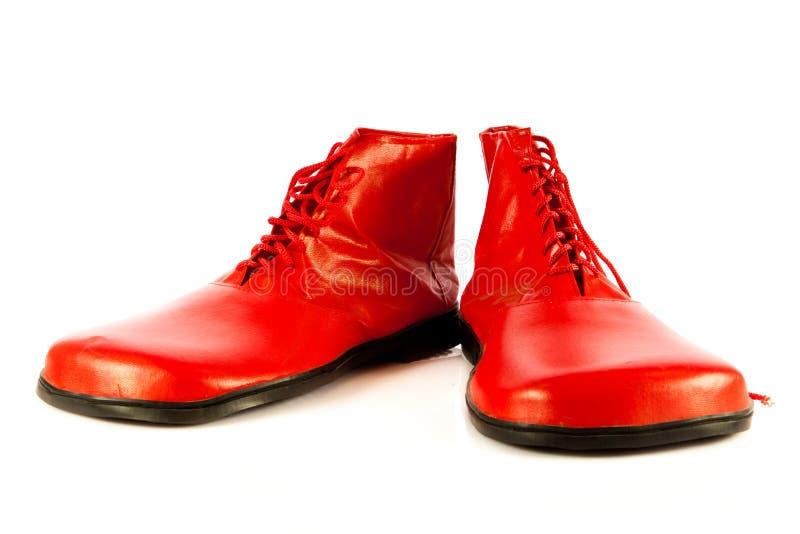 Смешные ботинки изолированные на белой предпосылке стоковые фотографии rf