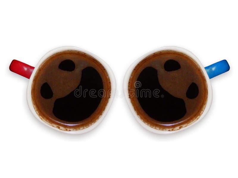Смешные кофейные чашки с сторонами smiley стоковые фото