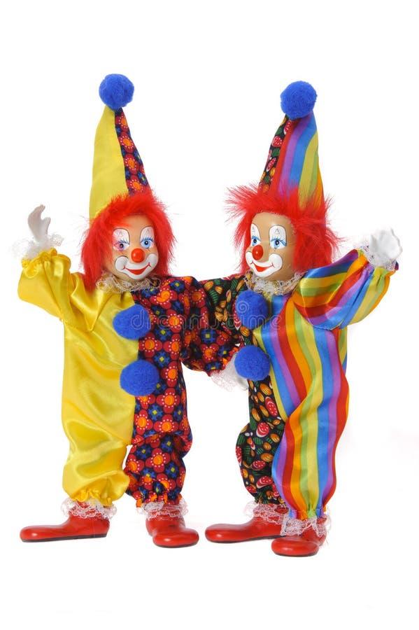 Смешные клоуны с красочным костюмом стоковые фото