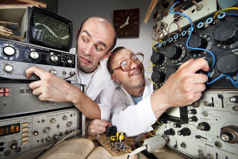 смешные научные работники 2 болвана стоковые фото