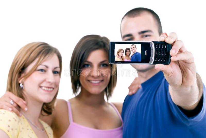 смешные фото принимая подростки стоковое фото