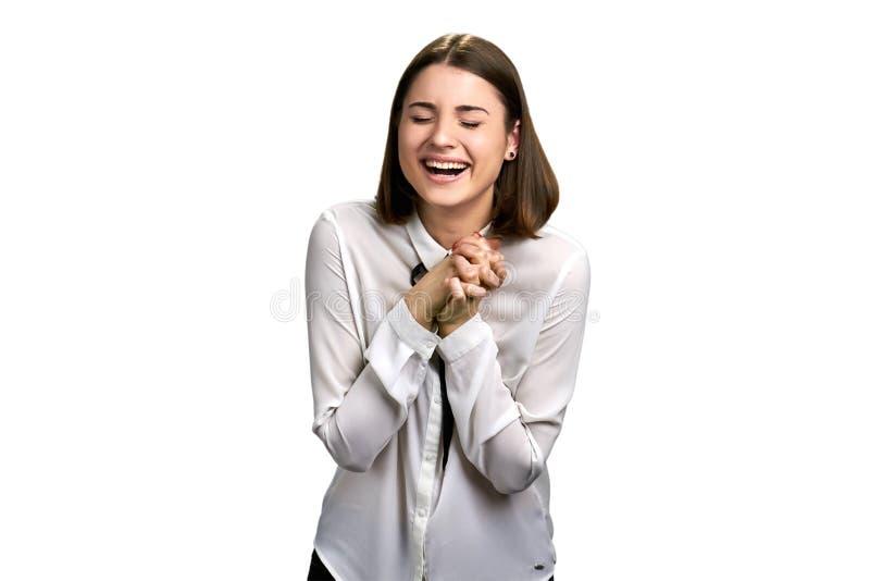 Смеясь над женщина изолированная на белой предпосылке стоковое фото rf