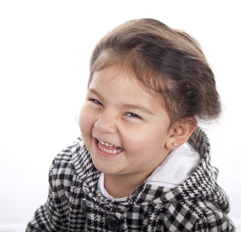 Смеясь над счастливая девушка стоковая фотография rf