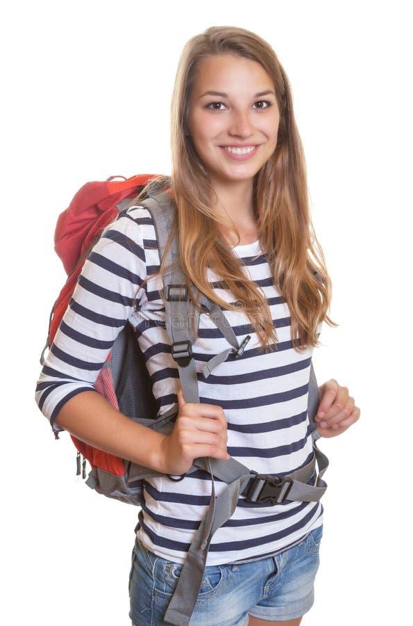 Смеясь над женщина с рюкзаком стоковые изображения rf
