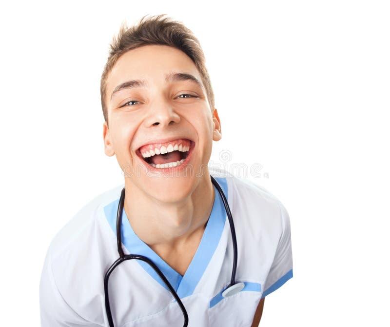 Смеясь над молодой доктор стоковая фотография