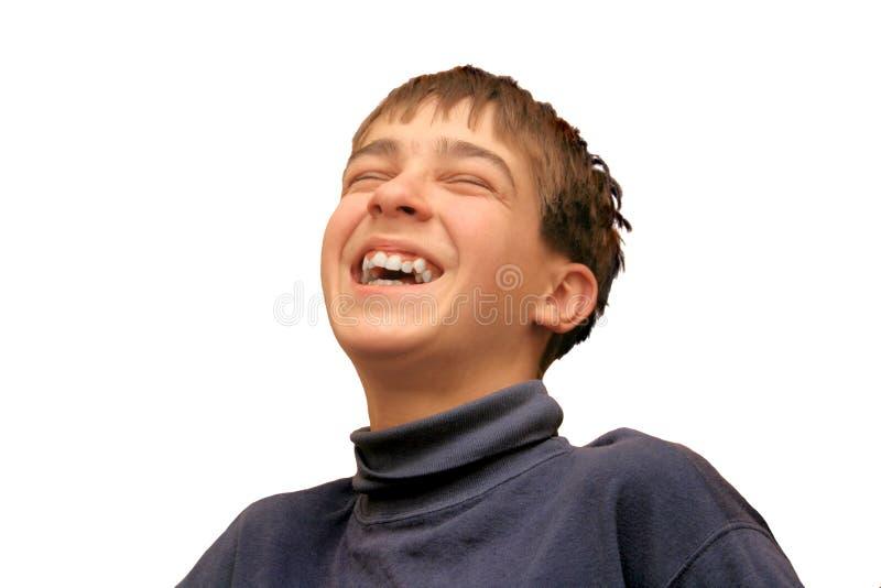 смеяться над мальчика стоковые изображения