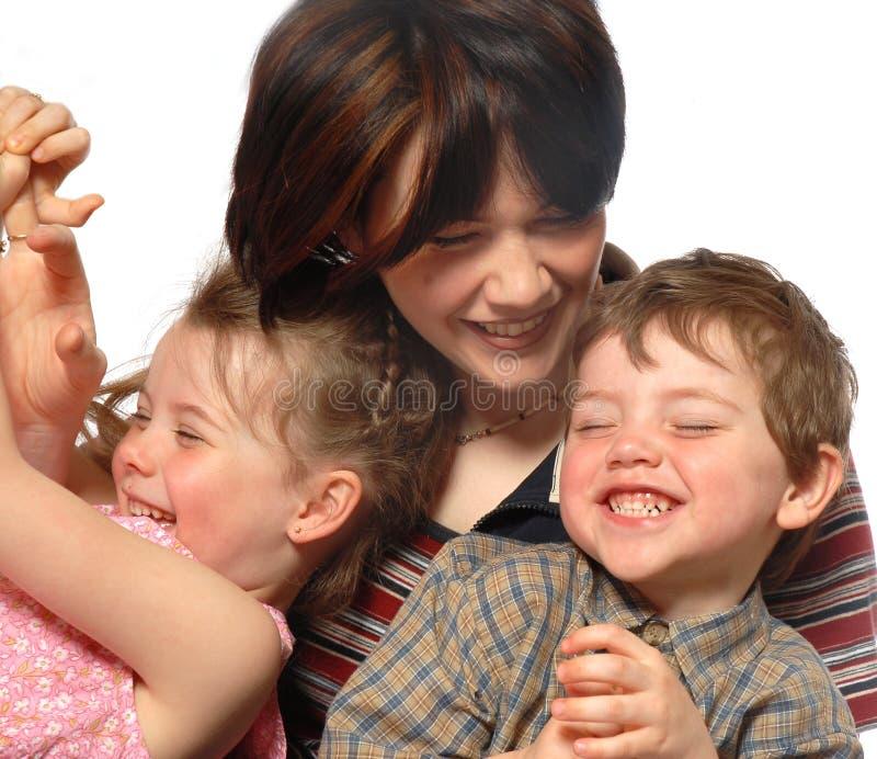смеяться над семьи стоковое изображение rf
