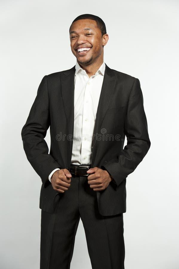 Смеяться над официально черноты одежды мужской стоковое изображение