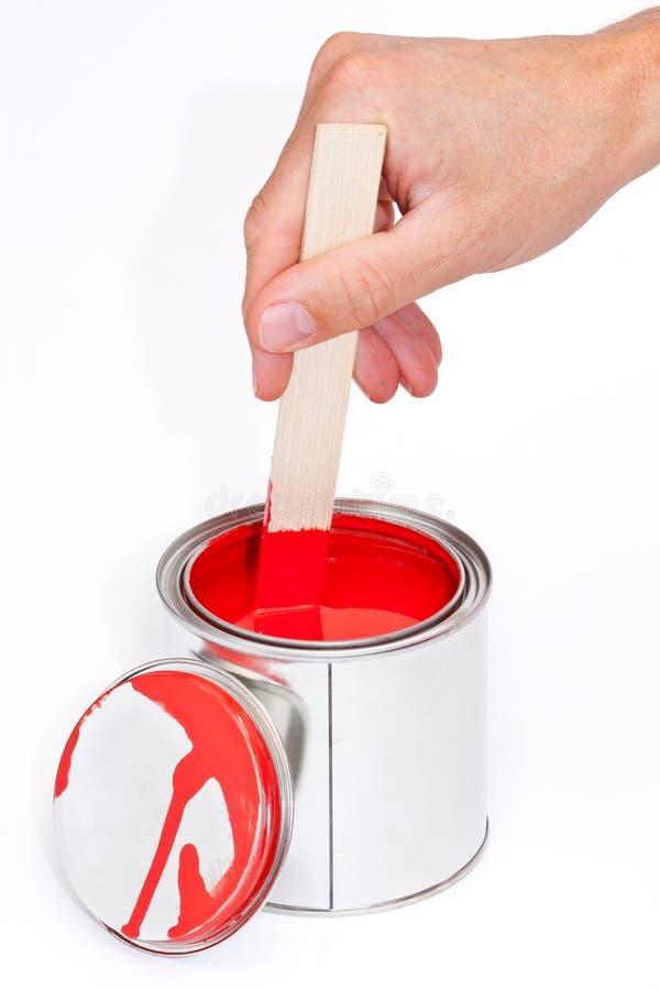 смогите покрасить stir деревянной стоковое изображение