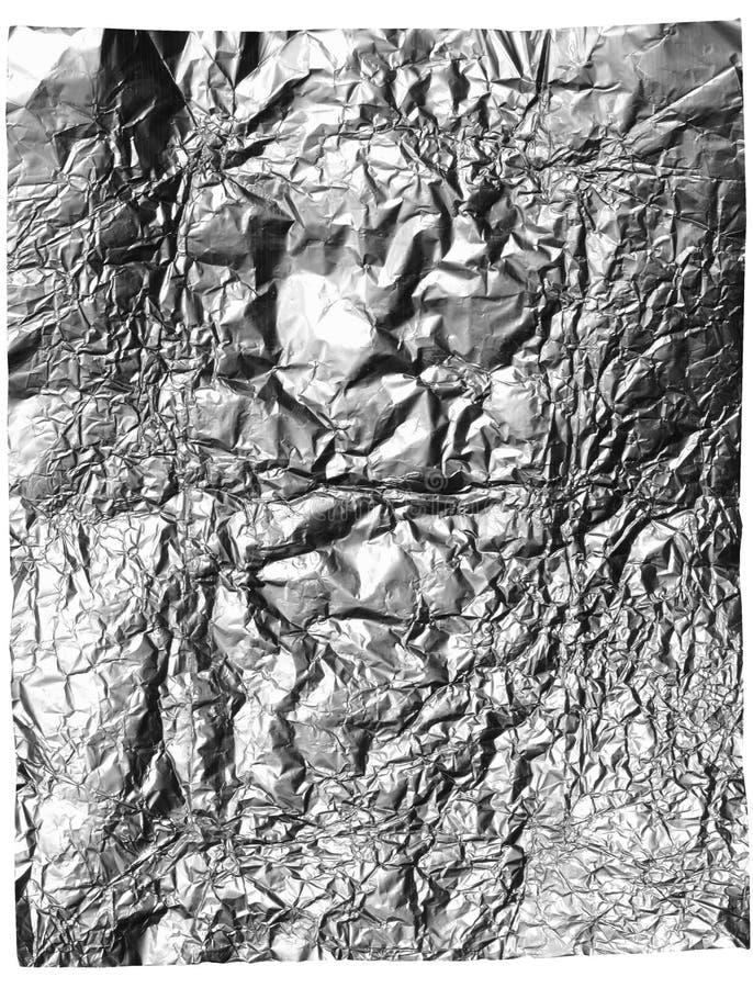 сморщенная белизна листа фольги конфеты серая изолированная стоковые изображения