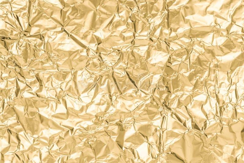 Сморщенная золотом бумажная предпосылка конспекта текстуры стоковое фото rf