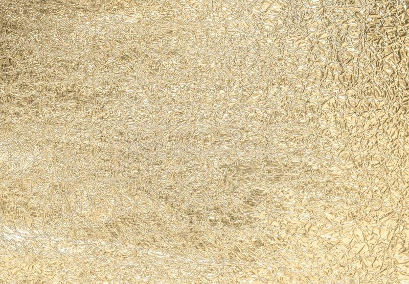 Сморщенная золотом бумажная предпосылка конспекта текстуры стоковые фотографии rf