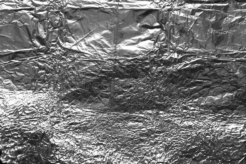 Сморщенная текстура предпосылки aluminuim от алюминиевой фольги стоковые изображения