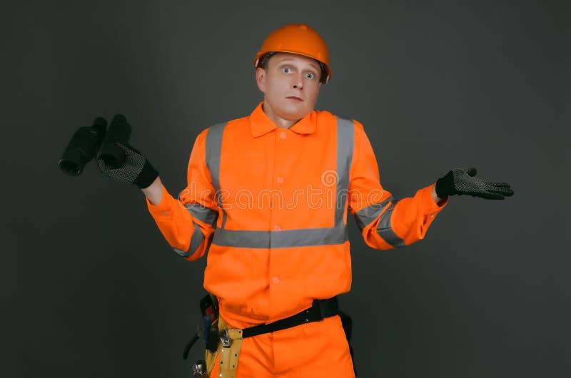 Смущенный построитель стоковое изображение