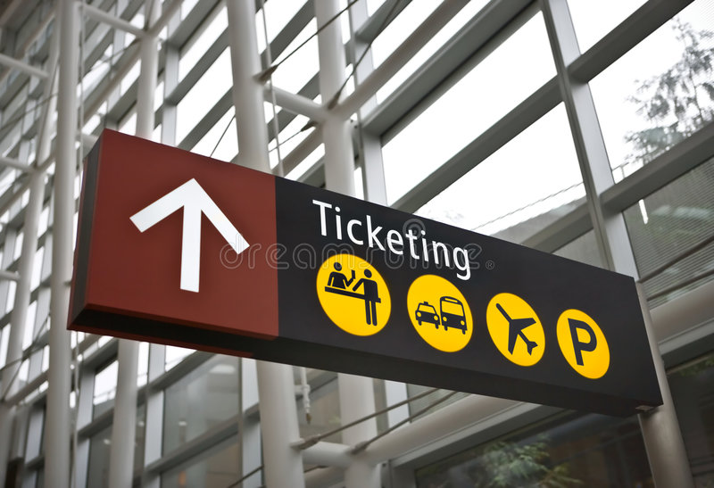 снабжать билетами знака seattle авиапорта стоковое фото rf
