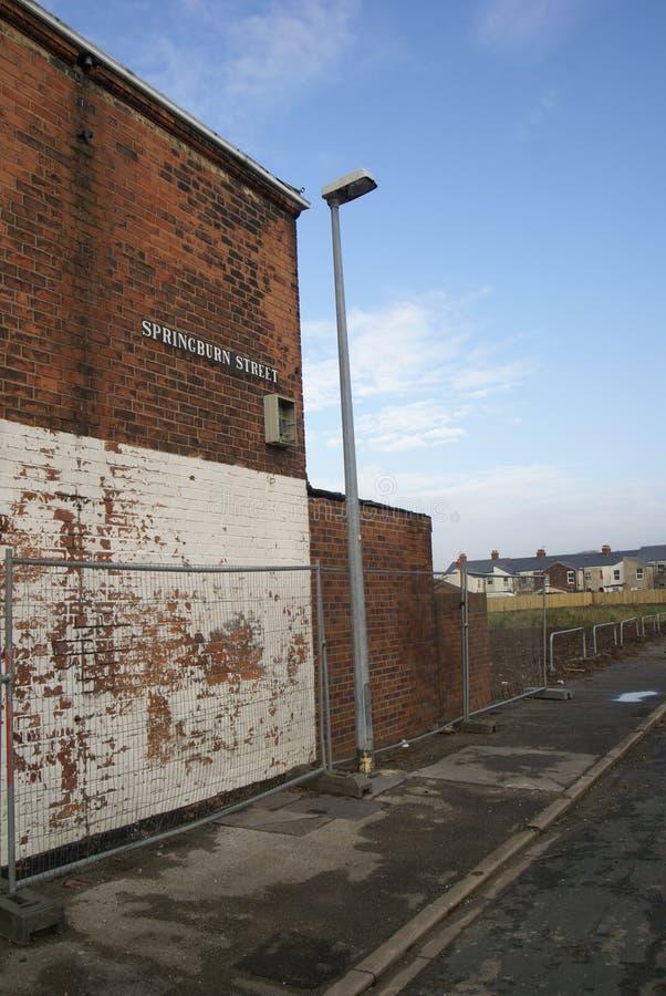 Снабжение жилищем трущобы, улица вальдшнепа, Кингстон на корпусе стоковая фотография