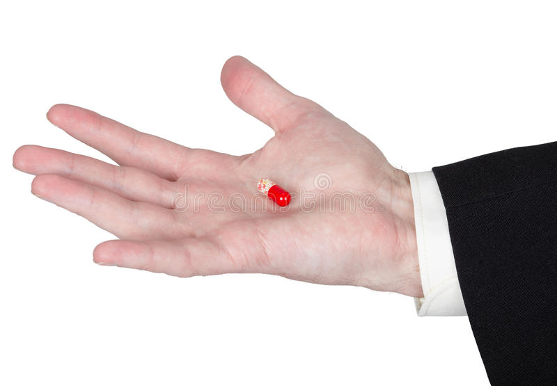 Снадобья таблетки седативные на ладони стоковые изображения rf