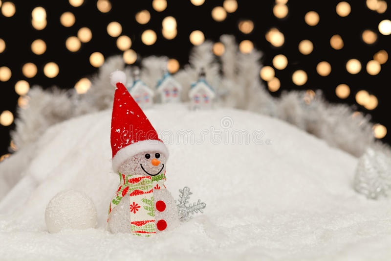 Снеговик в ноче рождества стоковое изображение