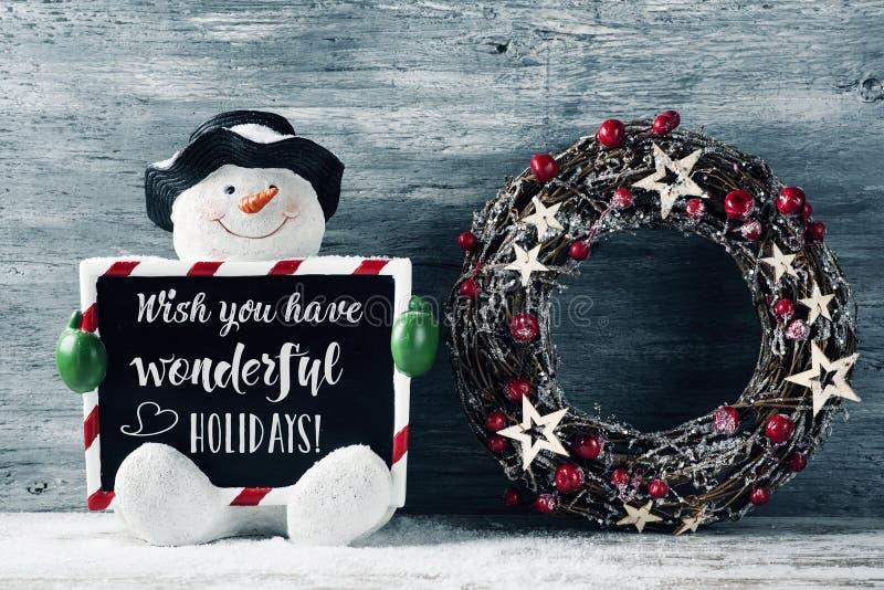 Снеговик и текст желают вы имеет чудесные праздники стоковое изображение