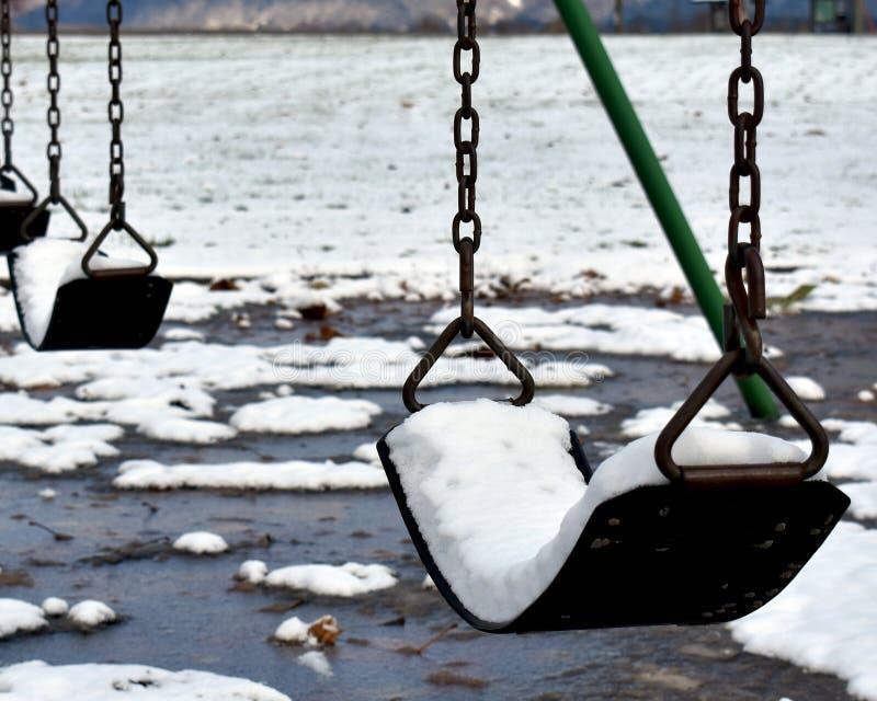 Снег заполнил качания стоковые изображения