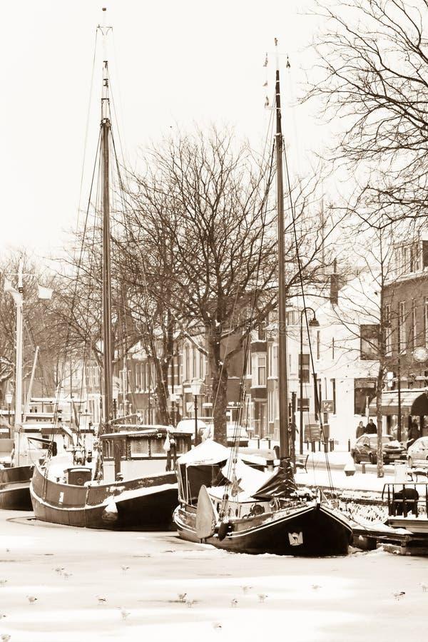 снежок sepia льда fishingboats старый стоковые фото