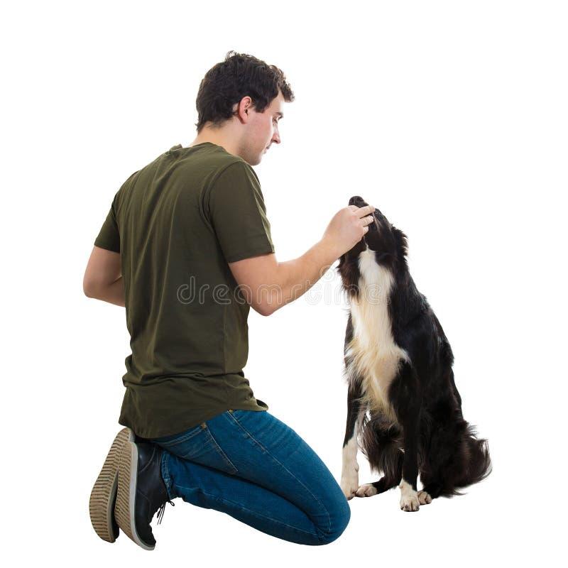 Собака человека подавая стоковое фото rf