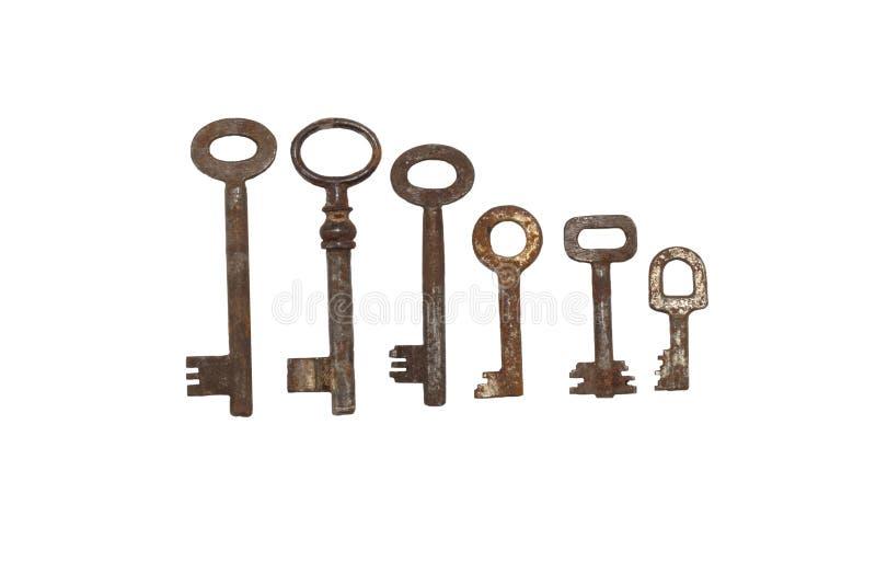 Собрание старых ржавых ключей стоковое фото
