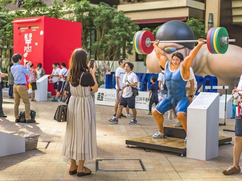 """Событие """"Токио 2020 изменения """"организованное на теме будущих Олимпийских Игр в Токио в 2020 стоковое фото"""