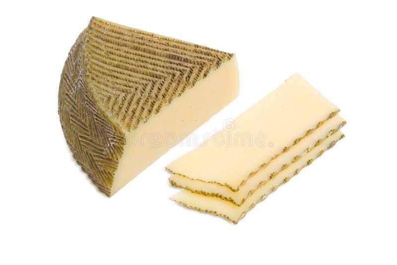 Соедините и несколько кусков испанского сыра на светлой предпосылке стоковая фотография rf