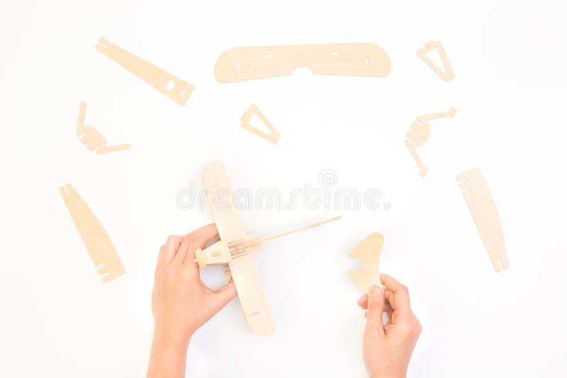 Создаваться или строить имеют концепцию дела Часть, конструкция и развитие самолета головоломки стоковое фото rf
