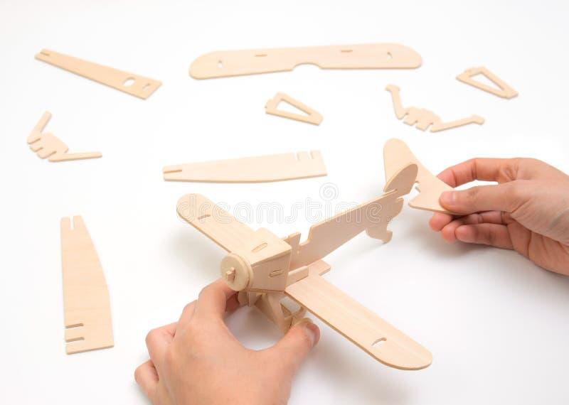 Создаваться или строить имеют концепцию дела Часть самолета головоломки стоковая фотография rf