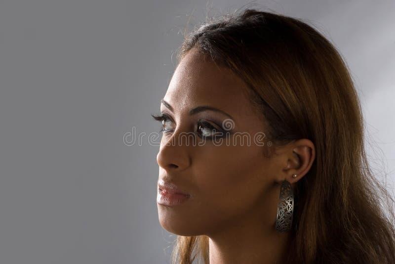 созерцательная женщина стоковая фотография rf