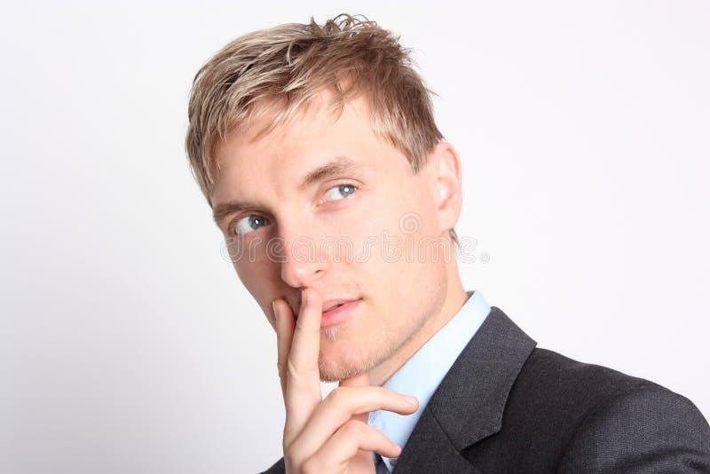 Созерцательно молодой бизнесмен стоковое фото rf