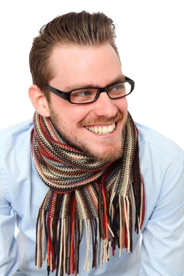Созрейте молодой человек в голубых рубашке и шарфе стоковое фото rf