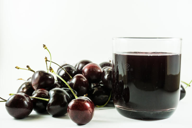 Сок и вишни вишни стоковые изображения rf