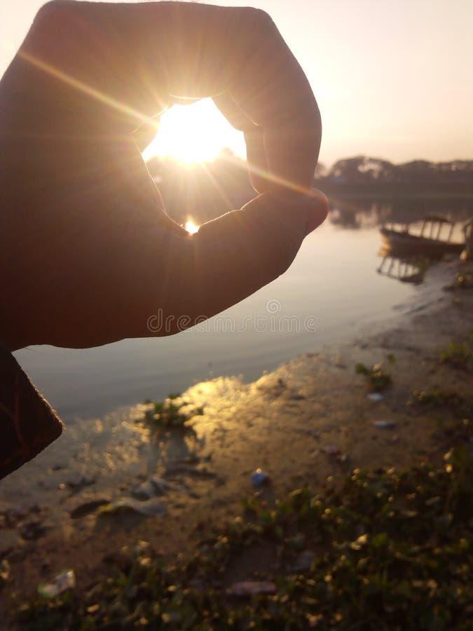солнце пальца стоковые фотографии rf