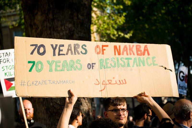 Сообщения протеста на Газа: Остановите ралли бойни в Уайтхолле, Лондоне, Великобритании стоковые изображения rf