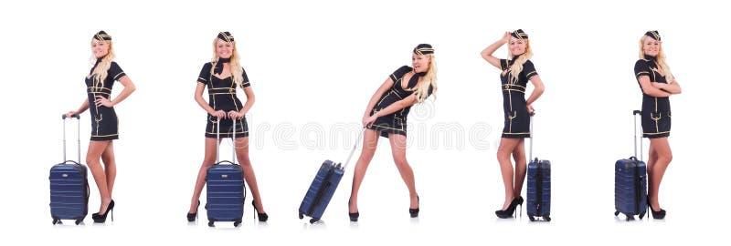 Сопровождающее лицо перемещения женщины с чемоданом на белизне стоковое фото