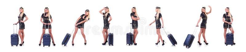 Сопровождающее лицо перемещения женщины с чемоданом на белизне стоковая фотография