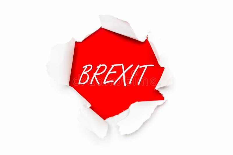 Сорванная бумага с письменным словом Brexit стоковое фото rf