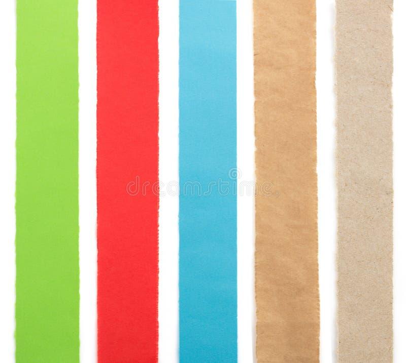 Сорванные бумажные прокладки на белизне стоковая фотография rf