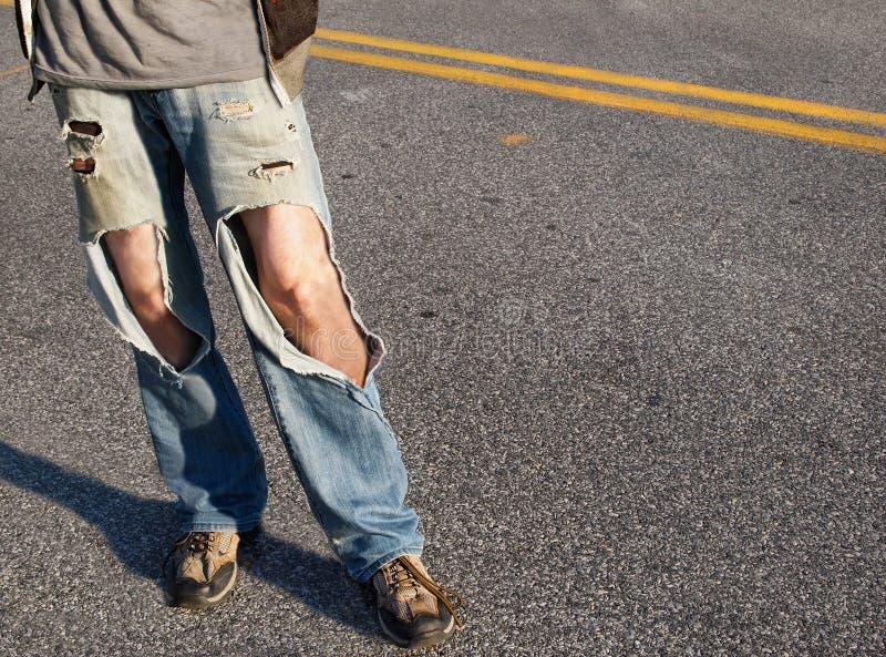 сорванные джинсыы стоковые изображения